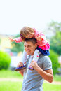 Happy father and baby girl having fun outdoors in colorful park Royalty Free Stock Photos