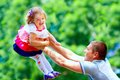Happy father and baby girl having fun in park colorful Stock Images