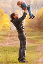 Happy father and baby outdoors. Stock Images