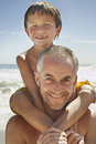 Happy Father Carrying Son On Shoulder Royalty Free Stock Photo