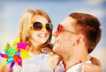 Happy father and child in sunglasses over blue sky summer holidays children people concept Stock Images