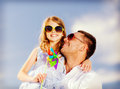 Happy father and child in sunglasses over blue sky summer holidays children people concept Stock Photo