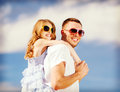 Happy father and child in sunglasses over blue sky summer holidays children people concept Stock Photography