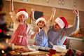 Happy father and children making Christmas cookies
