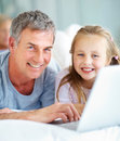 Happy father and cute daughter using laptop Stock Image