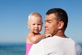 Happy father and daughter at beach his adorable little Stock Photography