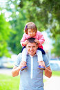 Happy father and daughter having fun in park colorful Royalty Free Stock Photography