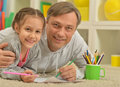 Happy father and daughter  painting Royalty Free Stock Photo