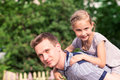 Happy father and daughter playing in the park smiling young Royalty Free Stock Image