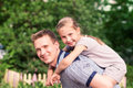 Happy father and daughter playing in the park smiling young Stock Photography