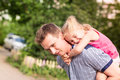 Happy father and daughter playing in the park smiling young Royalty Free Stock Images