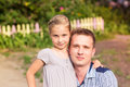 Happy father and daughter playing in the park smiling young Royalty Free Stock Photo