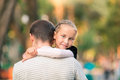 Happy father and daughter playing in the park smiling young Stock Image