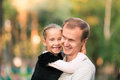 Happy father and daughter playing in the park smiling young Stock Photo