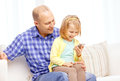Happy father and daughter with smartphone family children parenthood technology internet concept at home Stock Photos