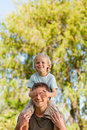 Happy father giving son a piggyback Royalty Free Stock Image