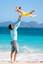 Happy father his adorable little daughter tropical beach having fun Royalty Free Stock Images