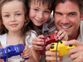 Happy father and his children playing video games Royalty Free Stock Photo