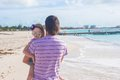 Happy father and his cute little daughter at beach Stock Images
