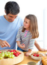 Happy father and his daughter having breakfast Royalty Free Stock Images