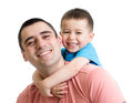 Happy father with his kid son on his back isolated white Royalty Free Stock Image