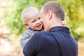 Happy father and his son outdoors. Child hugging daddy. Royalty Free Stock Photo