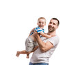 Happy father with his son young studio shot on white background Royalty Free Stock Photo
