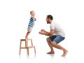Happy father with his son young studio shot on white background Stock Photography