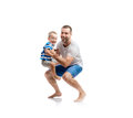 Happy father with his son young studio shot on white background Stock Image