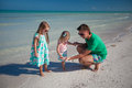 Happy father with his two kids on tropical beach vacation this image has attached release Stock Images