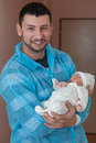 Happy father holding baby maternity ward Royalty Free Stock Photography
