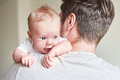 Happy father holding newborn baby in his arms Royalty Free Stock Photo