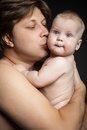 Happy father hugging and kissing his  newborn baby Royalty Free Stock Photo
