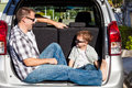 Happy father and son getting ready for road trip on a sunny day. Royalty Free Stock Photo