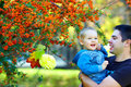 Happy father and son having fun colorful nature joyful Stock Photography