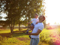 Happy father and son having fun enjoying sunny summer day Royalty Free Stock Photography