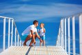 Happy father and son playing on blue sky horizon together Royalty Free Stock Photo