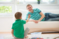 Happy father and son playing at home Royalty Free Stock Photo