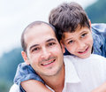 Happy father and son portrait of a smiling outdoors Royalty Free Stock Images