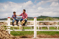 Happy Father And Son Smiling In Farm With Cows Royalty Free Stock Photo