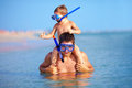 Happy father and son snorkeling in the sea Royalty Free Stock Image