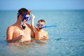 Happy father and son snorkeling in the sea Stock Image