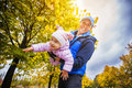 Happy father with a toddler in the autumn park Royalty Free Stock Photo