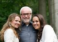 Happy father together with two smiling daughters close up portrait of a Royalty Free Stock Image