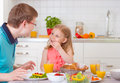 Happy father withpretty daughter having fun breakfast Royalty Free Stock Photo