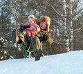 Happy father with years child playing on slide in winter Stock Image