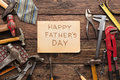 Happy Fathers Day background, card on rustic wood with repair tools Royalty Free Stock Photo