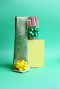 Happy fathers day card father's gifts green background bag tie yellow bows Royalty Free Stock Image