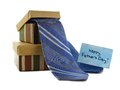 Happy fathers day card with gift boxes and ties over white Royalty Free Stock Images