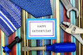 Happy fathers day father tag with ties and toy tools over patterned background Royalty Free Stock Photography